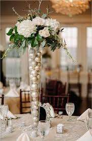 table arrangements sumatra lilies and bear grass loops in eiffel