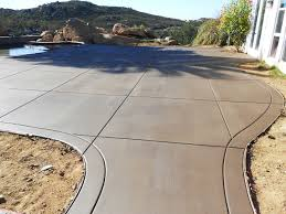 Pavers Over Concrete Patio by A Comparison Between Poured Concrete And Interlocking Pavers