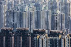 hong kong home prices reach record high after 8 month ascent