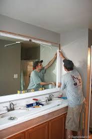 large bathroom mirror remodelaholic framing a large bathroom mirror for the home