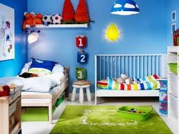 bold blue wall paint and shared beds furniture in modern kids