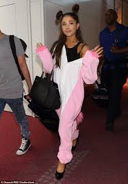 grande costume grande wears a fluffy animal costume for trip to tokyo