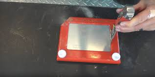 the inside of an etch a sketch will blow your mind the daily dot