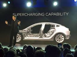 tesla says first model 3 to come off assembly line friday