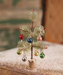 fashioned tiny feather tree with ornaments feather tree