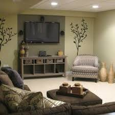 basement renovation brown couch couch and accent walls