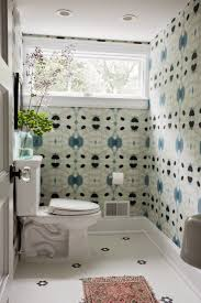 indigo blue and white patterned wallpaper in a bathroom black