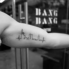minimalist tattoo bicep 40 small minimalist tattoos for men aesthetic ink ideas