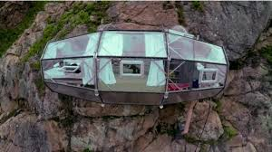 sleep on the side of a mountain in these vertigo inducing pods