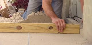 Installing Patio Pavers On Sand Paver Patio Sand Base Leveling Tip Today S Homeowner