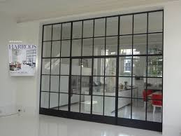 living room sliding glass partitions brown wooden frame interior
