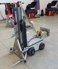Two Story Workshop Tirebot A Tire Workshop Robotic Assistant The European