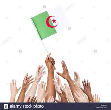 Algerian Flag Group Of People Reaching For And Holding The Algerian Flag Stock