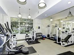 traditional home gym with pendant light u0026 high ceiling in