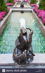 Rockefeller Center Summer Garden - statue of triton sitting on a fish rockefeller center channel