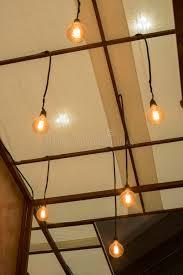 roof decoration vintage light bulb hanging on a roof for interior design lighting