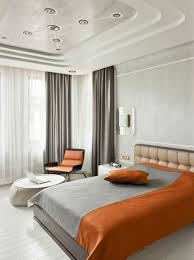 home design futuristic ceiling design with orange bedding themes