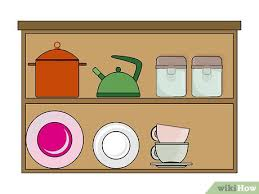 how to decorate the top of kitchen cupboards how to decorate the top of kitchen cabinets 15 steps
