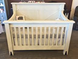 bedroom oak wood eddie bauer crib with vanity and nightstand on
