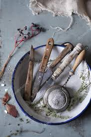 used kitchen knives used kitchen knives and vintage strainer on rustic blue wooden