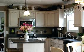 how to decorate top of kitchen cabinets ideas decorating top kitchen cabinets homes kitchen cabinet tops