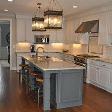 kitchens white cabinets white cabinets dark grey island lanterns above island kitchen