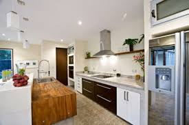 glorious kitchen with white glass tile backsplash and hardwood