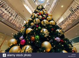 tree decorated with big balls at the of a