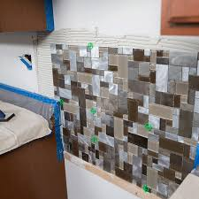 how to install a glass tile backsplash in the kitchen to install a tile backsplash
