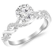 diamond wedding rings 0 5 carat twisting infinity gold and diamond split shank pave set