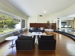 open concept kitchen living room designs open concept kitchen and living room with black sofa and brown floor