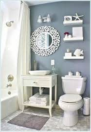 beach theme bathroom stone shower floating shelves shell decor