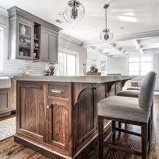 black walnut wood kitchen cabinets the island millwork is american black walnut in a 25