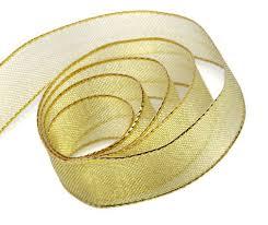 metallic gold ribbon metallic mesh gift ribbon in gold and silver box and wrap
