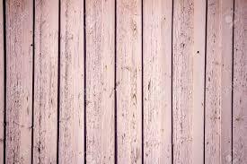peeling pink paint on weathered wood planks texture stock photo