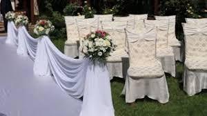 festive wedding ceremony decoration with light aisle on purple