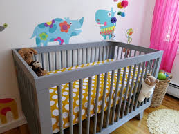 bedroom grey crib with yellow and white dotted bedding by