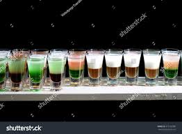 green cocktail black background line many drinking small glasses tasty stock photo 375152380