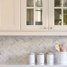 herringbone gray backsplash herringbone carrara white marble