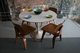saarinen tulip round dining table eames dcw chairs 4 circa