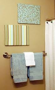 bathroom with fabric canvas art ideas over towel holder wall