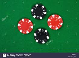 poker table top and chips two kinds of poker chips in the middle of green poker table top