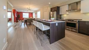 white kitchen cabinets with vinyl plank flooring whitewashed oak
