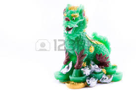 jade lion statue jade lion statue isolated on white background stock photo