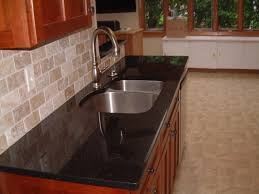 kitchen black granite countertops with tile backsplash cabinet