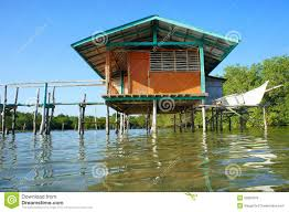 traditional fisherman u0027s house on stilts in the sea stock photo