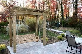 a custom patio a swing pergola a flower planter work bench