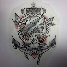 lovely old shark and anchor with flower tattoo design