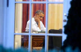president obama in the oval office u s president obama sits inside the oval office as he prepares