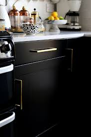 how to paint kitchen cupboard doors with a spray painting our kitchen cupboards black swoon worthy